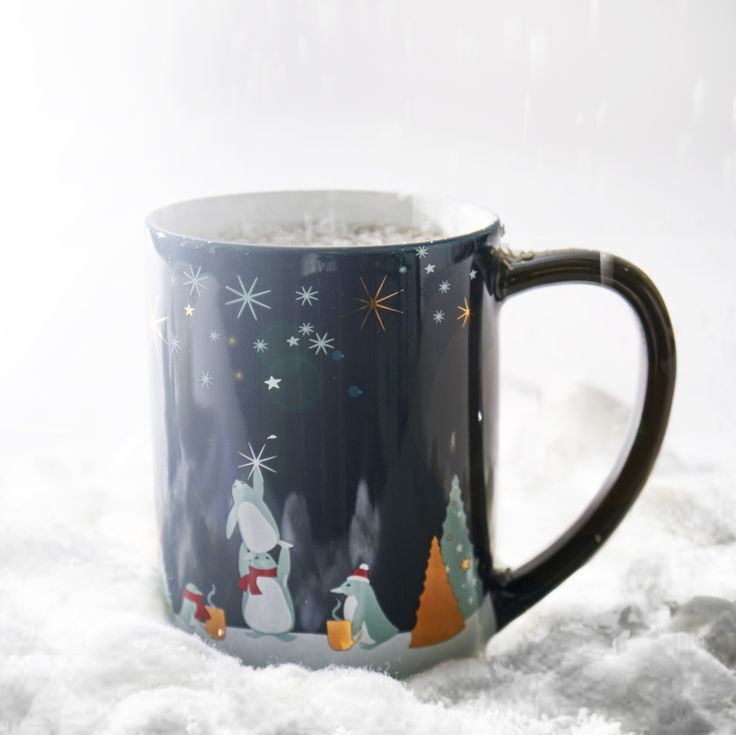 Ain't no party like a penguin party! Get into the holiday spirit with this festive infuser mug.