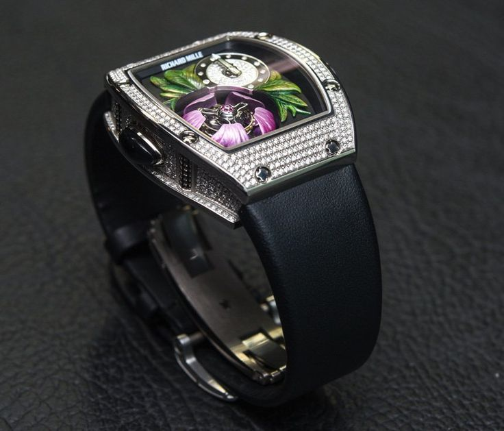 """Richard Mille RM 19-02 Tourbillon Fleur Watch Hands-On - on aBlogtoWatch.com """"When it comes to iconic shapes in watches, the Richard Mille tonneau case is certainly one of the more notable. Also notable is the fact that watch models aimed at women generally have a plethora of jewels plastered all over them, and while I am generally averse to that particular styling trick, I am about to give it a pass..."""" #SIHHABTW"""