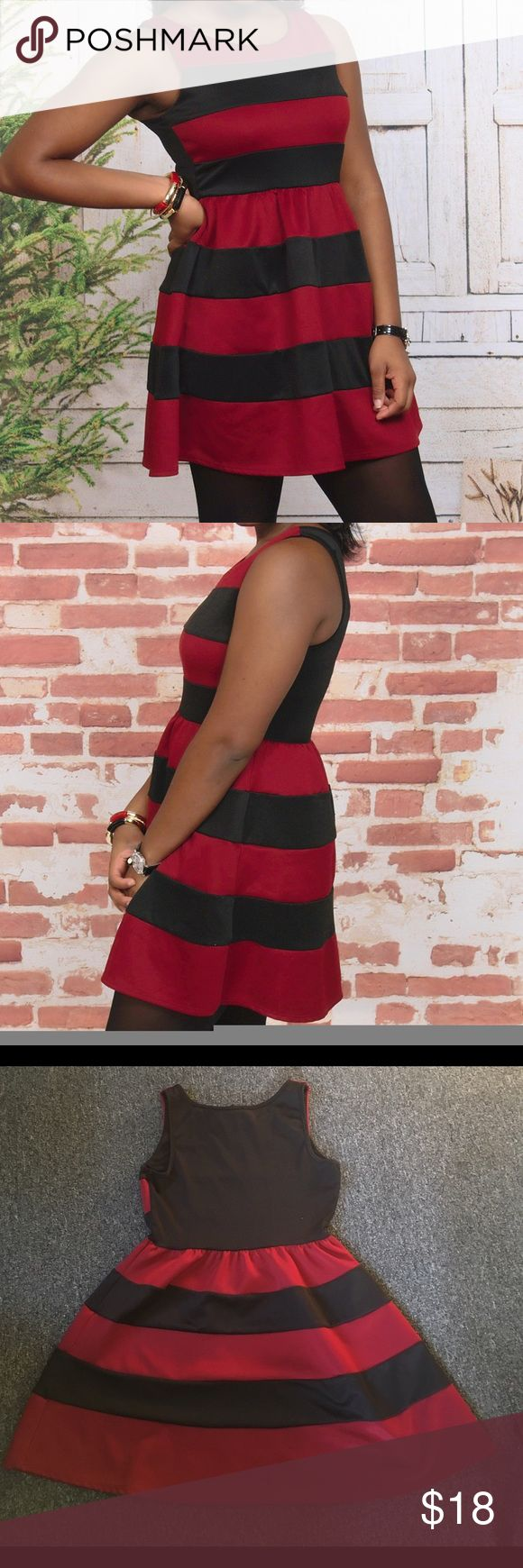 Cute Skater dress. From Wet Seal deep red & black Gently loved. Worn to Christmas program and church. Very little lint on black stripes. Wet Seal Dresses