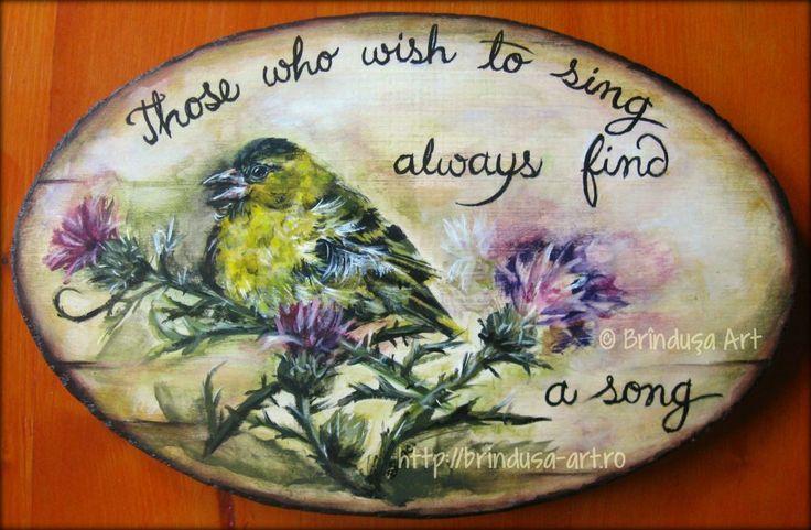 """Brîndușa Art """"Those who wish to sing always find a song"""" (Swedish proverb) Siskin, acrylic painting on wood. 12 x 7.6 inches ( 30.5 x 19.5 cm). """"Cei care doresc să cânte găsesc întotdeauna un cântec"""" (Proverb suedez). Scatiu, tablou pictat pe lemn în culori acrilice. 30,5 x 19,5 cm. #woodpainting #picturapelemn #birds #pasari #thistle #song #siskin #inspirational #acrylics #acrilice #BrindusaArt #handmade"""