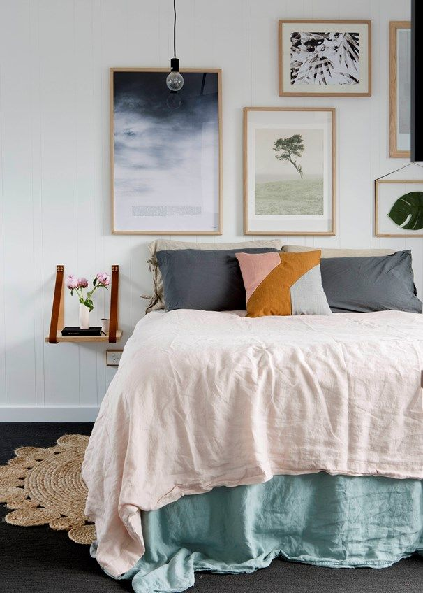 The bed is a textural delight dressed in a Cultiver blush linen quilt, grey pillowcases from Adairs, decorative cushion and a House Of Baltic Linen valance.