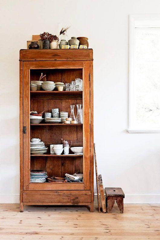 vintage wood cabinet with dishware displayed / sfg…