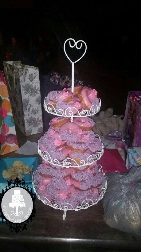 donut cake tower bubblegum and passion fruit flavour  $65  for 50 donuts  cheaper option then a birthday or wedding cake.  can be arranged in many ways.  great idea to add to your sweet table.   #donuts #donuttower #donutcakes #strawberrydonuts #ballerina #caketoppers #smile #beer #sunday #cakesstgeorge #stgeorge #sweetheart #passionfruitdonut #bubblegum #bubblegumdonut #passionfruit https://m.facebook.com/customcaketoppersandsupplies