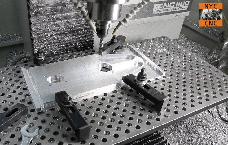 """Again, another example of working a large aluminum bracket in a """"home machine shop"""" -- using SprutCAM to program part, a DiAcro shear to trim a sub plate, then machining on the Tormach PCNC Mill!"""