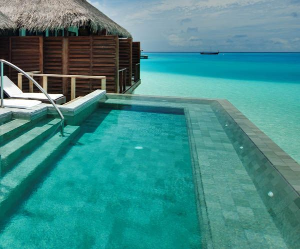 Love the link between the ocean and the pool! Velassaru Maldives
