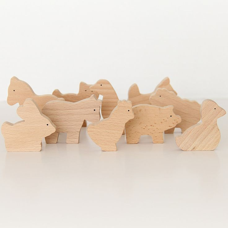 The set consists of 10 different animals made of beech wood. Children can use their imagination freely when playing with these gorgeous natural wooden animals.  Size: 5.5 - 6.5 cm; 10 mm widthSuggested Age: 3+Set includes: duck, chicken, cat, horse, dog, rabbit, goose, pig, cow