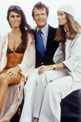 Caroline Munro as Naomi, Roger Moore as 007, and Barbara Bach Anya Amasova, between takes whilst filming the 1977 Bond film 'The Spy Who Loved Me'