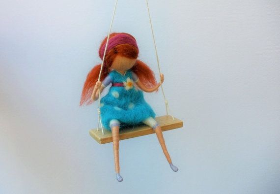 Redhaired girl on a swing with blue dotted dress by Freyjafairies