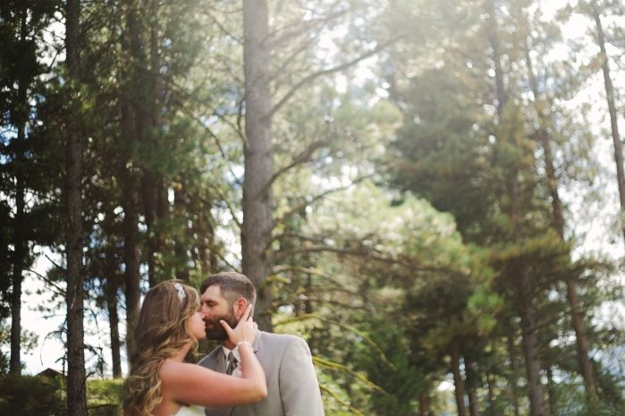 Double Arrow Resort Seeley Lake MT Wedding Photos Couple Kissing