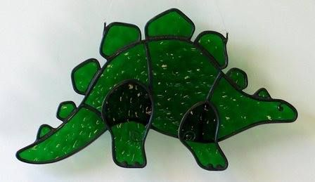 "New stained glass artwork, handmade by Gary & Linda Peterson! ""Dinosaur"" $30. #genswartgifts #glass"