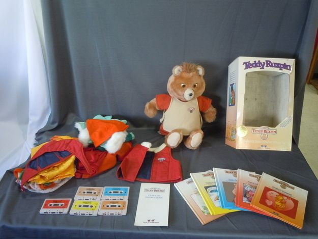 1985 Teddy Ruxpin lot with tapes, books, and clothes, worth $239.95.Whhhhat? My cousin had this as well
