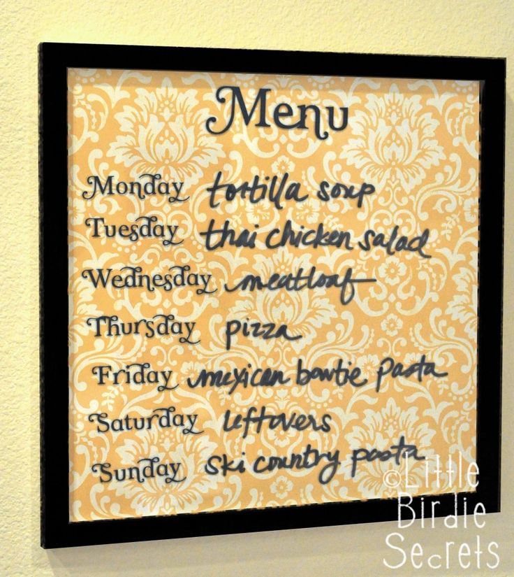 Wipe-Off Menu Board Tutorial    Supplies:        * Picture frame with glass front (I love these 12×12 frames I found at Ben Franklin for only $7!)      * Piece of patterned scrapbook paper to fit in your frame (mine's also 12×12)      * Optional: Vinyl cut letters for each day of the week (you could always just hand write them)      * Dry-erase marker