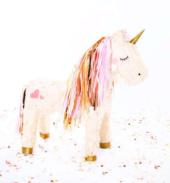 This majestic baby unicorn piñata has magical artwork that feature rosy cheeks with a pink and rose gold mane and tail, a rose gold glittered