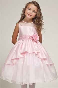 Pink satin skirt cut short and opens up like curtain to expose mirror organza inner layer. Bodice is exact opposite of the skirt inner layer is satin with over layered with organza, seamless neck and armhole bind with bridal satin. Flower Girl Dress.