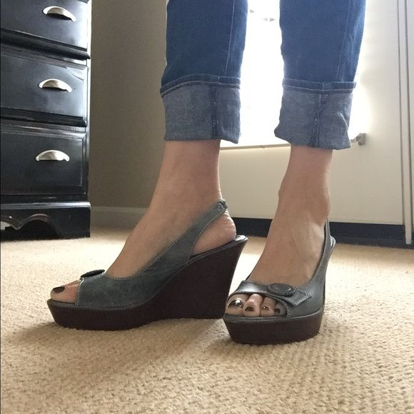 Cole Haan Distressed Denim Leather Wedges Ok ladies, these are amazing shoes! My friends mom had them in her closet and had barely worn them. No scuffs or wear to the leather or to the elastic at back of strap. The sole is a cushion sole, you seriously could go for a run in these beauties. Perfect for summer Cole Haan Shoes Wedges