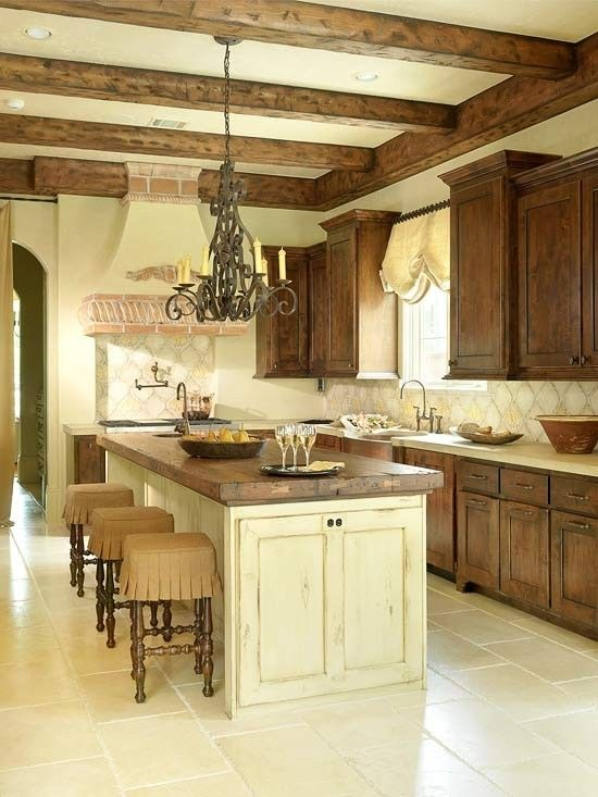 Tuscan-Influenced Kitchen--love the wood beams and butcher block top on the island....and the stools!
