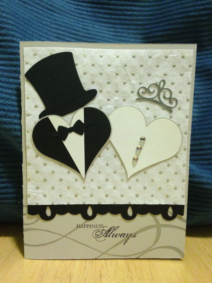 I love this card! Made by Jennifer Wagner using heart shape from Cricut Plantin SchoolBook cartridge, top hat and bow tie from the penguin as well as tiara from the cat in Cricut Create a Critter 2 cartridge, and the border from Cricut Elegant Edges cartridge.
