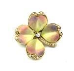 Dogwood flower - Antique American enamelled gold, diamond, and half pearl flower brooch by Krementz, Newark   with a central diamond, four pink and yellow petals with part half pearl border and a half pearl stem