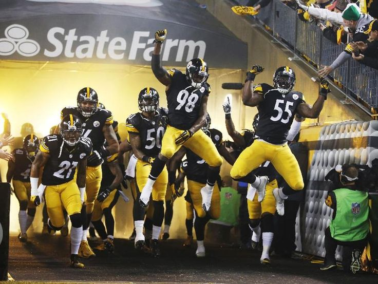 The Pittsburgh Steelers take the field as they are introduced before an NFL wildcard playoff football game against the Baltimore Ravens, Saturday, Jan. 3, 2015, in Pittsburgh. (AP Photo/Gene Puskar)