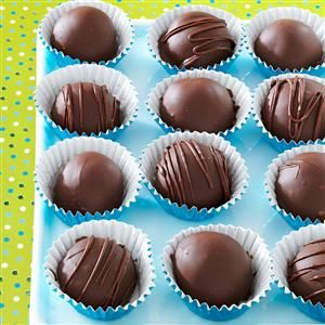 Caramel Truffles Recipe -These candies disappear as fast as I can make them. The five-ingredient microwave recipe is easy and fun to make. When drizzled with white chocolate and packaged with ribbon, they're a pretty gift. —Charlotte Midthun, Granite Falls, Minnesota