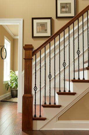 Craftsman Staircase with Chair rail, High ceiling, Wainscotting, Hardwood floors