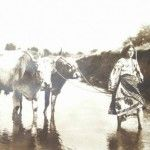 Romanian girl crossing the river in 1910