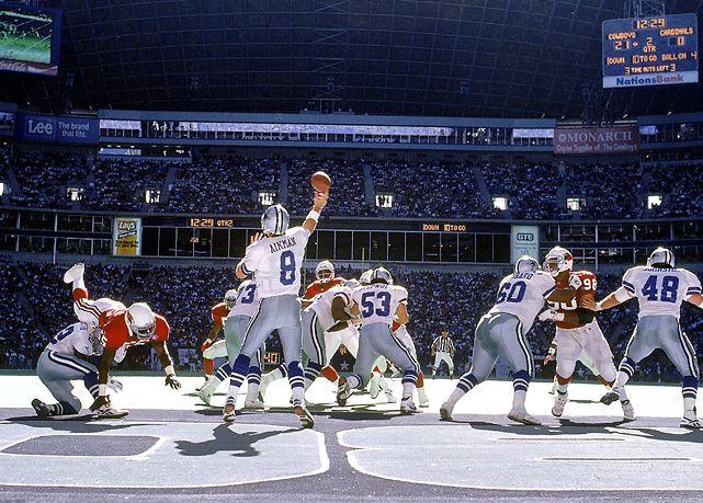 Dallas quarterback Troy Aikman throws a pass during a 1994 Cowboys-Cardinals game. (Al Tielemans/SI)