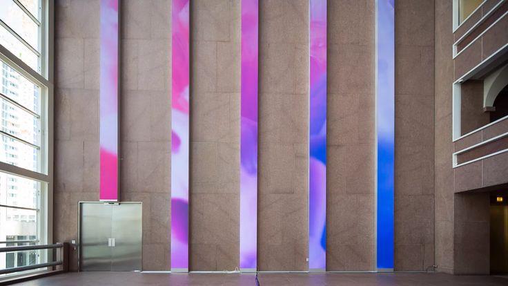 Inside the immense street-level glass atrium of the Wells Fargo Center in…