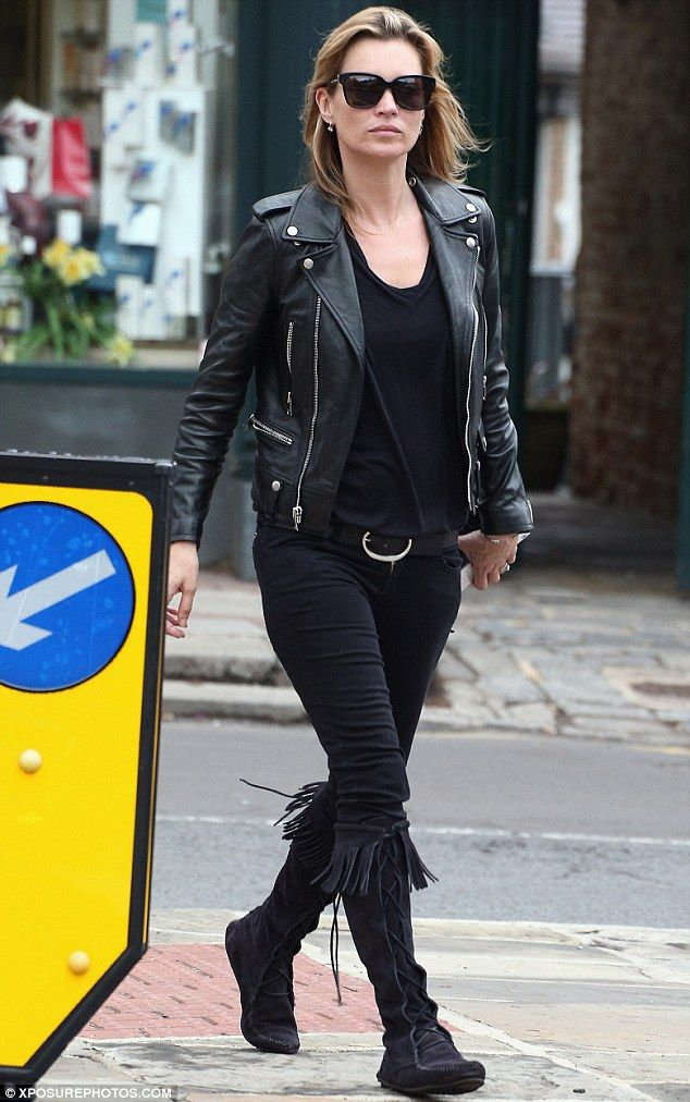 Rock chick: The 39-year-old supermodel opted for a low-key look in a leather biker jacket, skinny jeans and tassle-detail boots