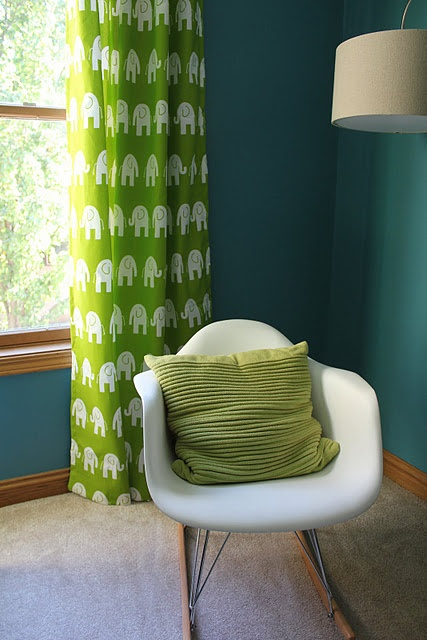 love the teal wall color & the curtains!!