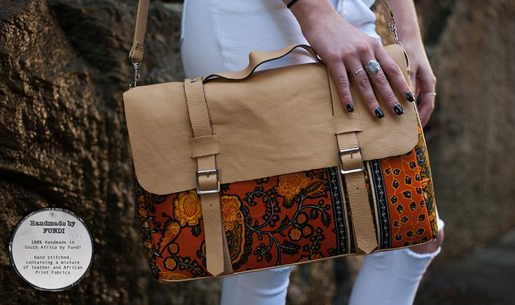 Zarla, a striking large study/laptop bag. Each bag is hand stitched using traditional African fabrics and leather. Available at Modern Tradition - Where tradition meets today!