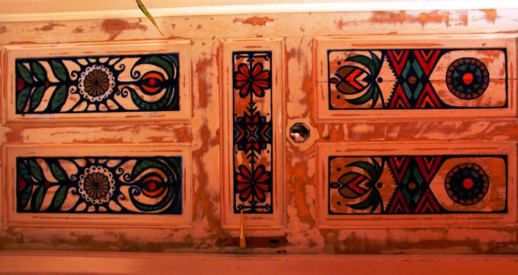 Painted and distressed door with bagua