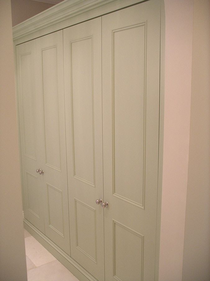 Sometimes I think I want this to be my butlers pantry. Just a bunch of shelves behind doors to store all my dishes and appliances... I like the color of these doors.