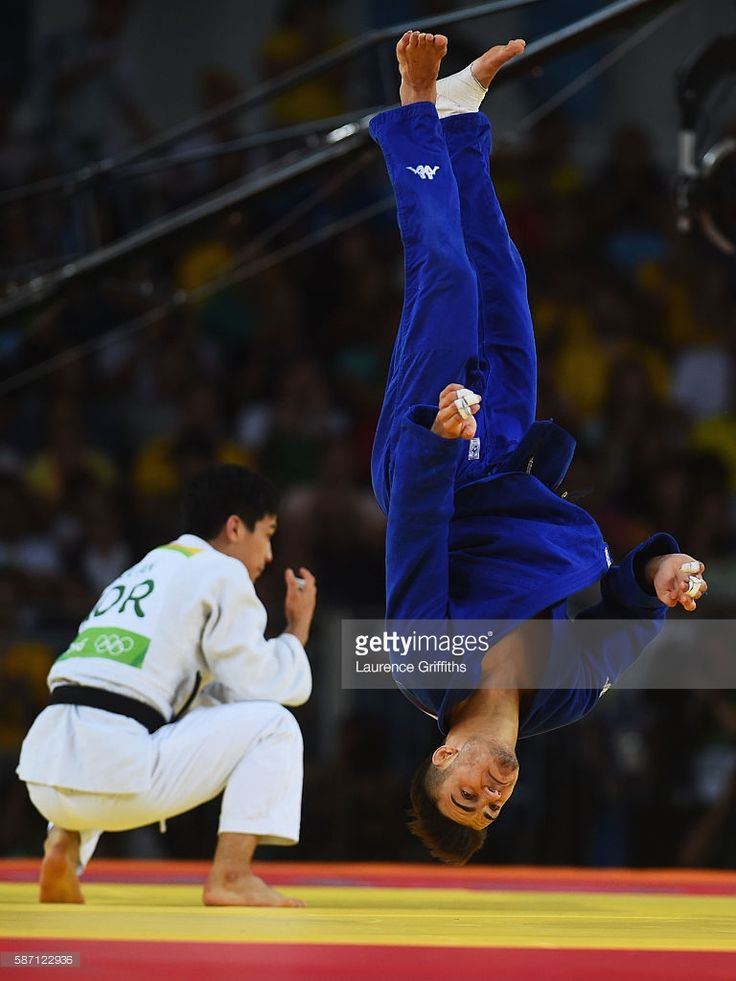 Fabio Basile of Italy performs a flip as he celebrates winning the gold medal against Baul An of Korea during the Men's -66kg gold medal final on Day 2 of the Rio 2016 Olympic Games at Carioca Arena 2 on August 7, 2016 in Rio de Janeiro, Brazil.