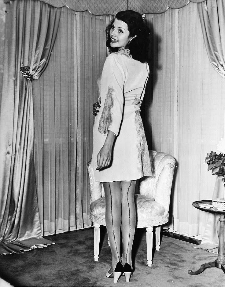 af8c51208 Rita Hayworth modeling silk stockings