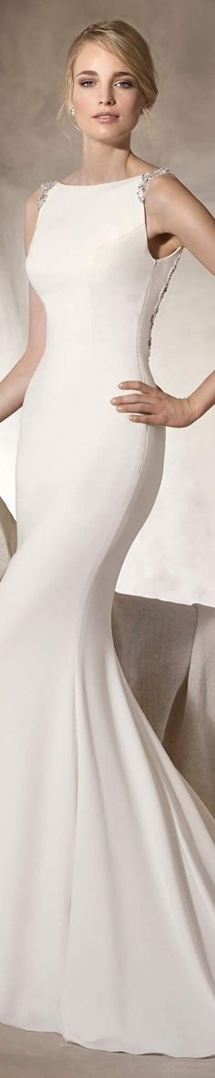 La Sposa Bridal 2017 Haliza Elegant mermaid wedding dress in crepe and tulle, bateau neckline and beautiful gemstones on the shoulders and back.