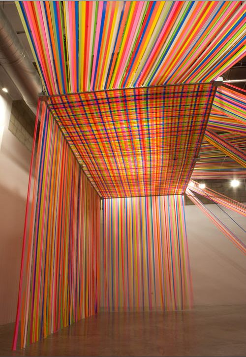 Tape / bright and lovely flagging tape installation from Megan Geckler.