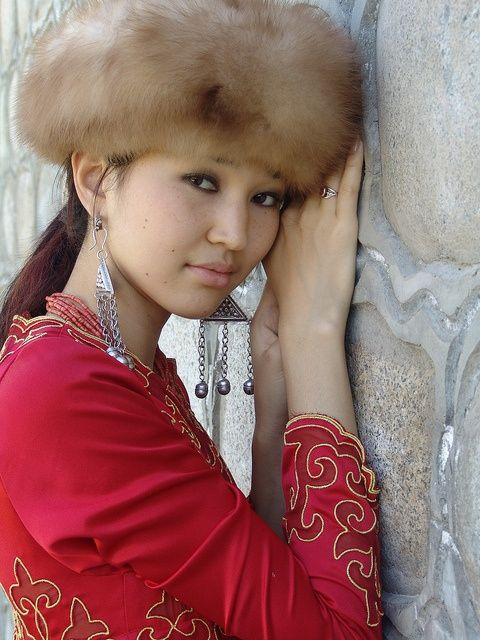 Kyrgyz woman in traditional dress and fur hat, Kyrgyzstan. http://www.AsianDatingLobby.com http://www.facebook.com/AsianDatingLobby