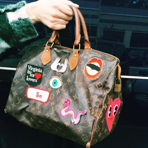 Patches on a vintage Louis Vuitton speedy