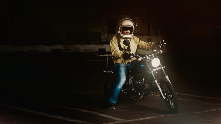 Man Wearing White Full Face Helmet Riding on Standard Motorcycle  Free Stock Photo