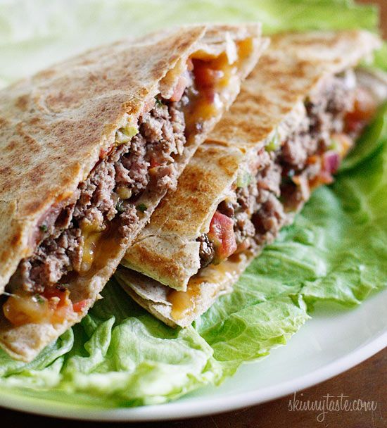 Skinny Buffalo Burger Quesadilla - 100% grass-fed buffalo burgers with melted cheddar jack cheese and pico de gallo wedged in between two whole wheat tortillas. No pink slime in these burgers!! Because the meat is so lean, you have to cook it for less time than you would a fattier ground beef burger or it will become dry and overcooked. 8points+ #weightwatchers #sandwich #buffalo