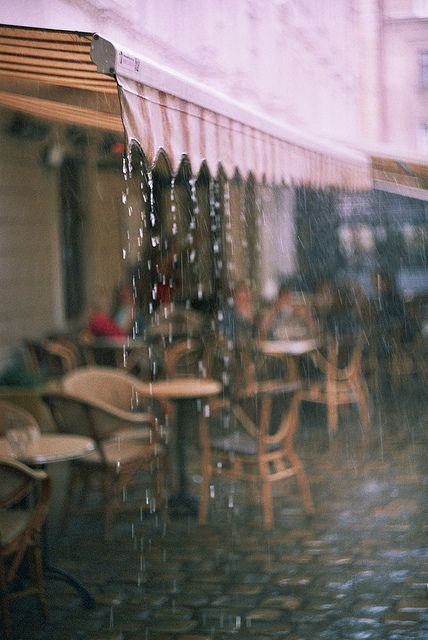 Warm summer thunderstorm in the city. The smell of wet asphalt and reflections in pavement. Photo - Crush Cul de Sac