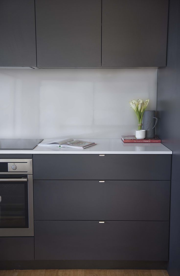 Red Lily Renovations - Perth.  Matt Grey Cupboards.  Pure Stone Benchtop.