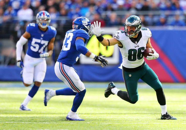 Eagles vs. Giants:  28-23, Giants  -  November 6, 2016  -       Zach Ertz of the Philadelphia Eagles runs with the ball after making a catch against Andrew Adams of the New York Giants at MetLife Stadium on Sunday, Nov. 6, 2016 in East Rutherford, N.J.