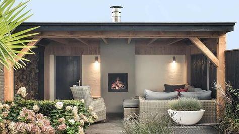 Mooi hardhouten vlonder met loungeset en open haard / houtkachel in douglas houten veranda. Ontwerp/ realisatie Buitenpracht Stijlvolle Houtbouw Barneveld.