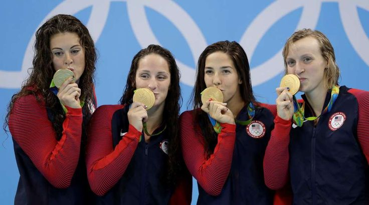 Katie Ledecky's team was behind by nearly a second at start of her leg, won gold by 1.84 seconds - August 11, 2016 - United States' Allison Schmitt, Leah Smith, Maya DiRado and Katie Ledecky, from left, kiss their medals during the women's 4 x 200-meter freestyle relay medals ceremony during the swimming competitions at the 2016 Summer Olympics, Thursday, Aug. 11, 2016, in Rio de Janeiro, Brazil.