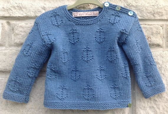 A Sweater with anchors giving it a nautical theme is hand knitted with Baby Cashmere, Merino and Silk Yarn, to fit a baby aged 6-12 months. A smart