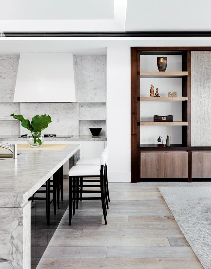Kitchen benchtop in White Fantasy marble and splashback in Carrara marble.   Photo: Felix Forest   Story: Belle