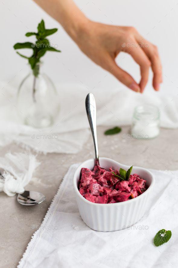 Beetroot Dip in White Dish with Female Hand Seasoning in Background - Stock Photo - Images Download here : https://photodune.net/item/beetroot-dip-in-white-dish-with-female-hand-seasoning-in-background/18918129?s_rank=1&ref=Al-fatih