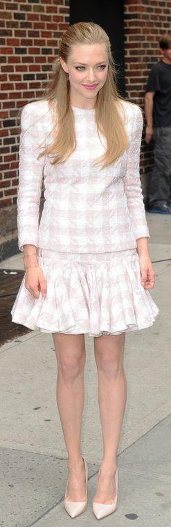 Amanda Seyfried: Jacket and skirt – Balmain  Shoes – Rupert Sanderson